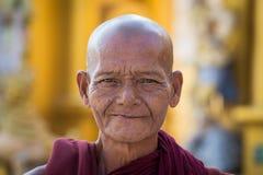 Burmese monk visit the Shwedagon Pagoda. Yangon, Myanmar, Burma Stock Photography