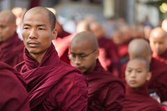 Burmese monks queueing for meal Royalty Free Stock Photos