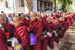 Burmese monks queueing for meal Stock Image