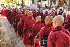 Burmese monks queueing for meal Royalty Free Stock Image