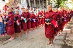 Burmese monks queueing for meal Stock Photos
