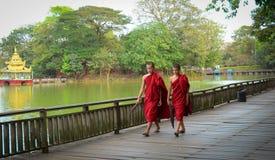 Burmese monks walk around Kandawgyi Lake Stock Image