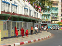 Burmese monks walking on street in Yangon Stock Image