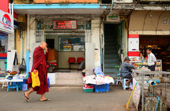 Burmese monks walking on street in Yangon Royalty Free Stock Image
