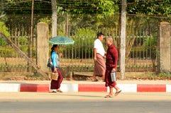 Burmese monks walking on street in Yangon Royalty Free Stock Photography