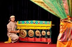 Burmese musician playing gongs Stock Photography