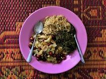 Burmese style tea leaf salad. Burmese Myanmar tea leaf salad with variety of fried nut and ginger royalty free stock image