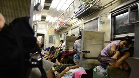 Burmese people and foreigner traveler sitting and sleeping on train stock video footage