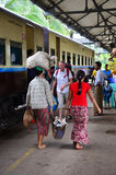 Burmese people and foreigner traveler waiting train at railway station Stock Photos
