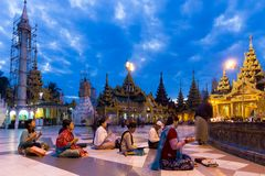 Burmese people praying Buddha at dawn Stock Photos