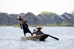 Burmese People Rowing Canoe Stock Photos
