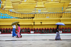 Burmese people walking at Shwemawdaw Paya Pagoda in Bago, Myanmar. Stock Image