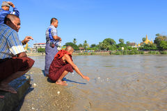 The Burmese people were feeding the fish at Yelapaya Pogoda. Stock Photo
