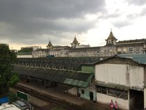 Burmese railway station and train. Yangon, Myanmar. View of the old train that makes the circular route in the city of Yangon, Myanmar royalty free stock photography