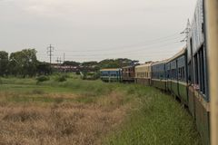 Burmese railway and train. Yangon, Myanmar. View of the old train that makes the circular route in the city of Yangon, Myanmar stock images