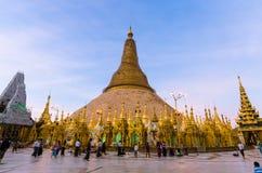 Burmese's fate for Shedagon Pagoda at twilight. Burmese's fate for Shedagon Pagoda at twilight, quinquennial preservation, Yangon, Myanmar stock photo