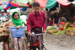 Burmese sellers riding bicycle Royalty Free Stock Images