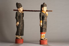 Burmese statues of carriers of gong Royalty Free Stock Photo