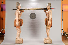 Burmese statues of carriers of gong Royalty Free Stock Photos