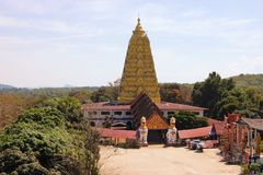 Burmese temple with lion in Sangkhlaburi, Thailand Royalty Free Stock Image
