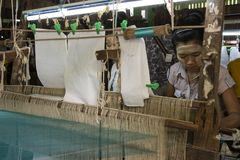 Burmese weaving machine. Detail of the pieces of the machine, with threads of various colors royalty free stock images
