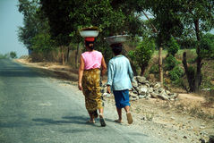 Burmese woman carrying on their heads. Stock Photography
