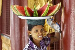 Burmese Woman Carrying Watermelon Royalty Free Stock Image