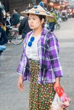 Burmese woman in hat shopping. Mae Sot, Thailand - February 3rd 2019: Burmese woman in hat shopping on the market. The market is open every day stock photography