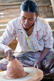 Burmese woman. NYAUNG SHWE, SHAN STATE, MYANMAR - JANUARY 12: Burmese craftswoman poses for a photo at work on January 12, 2012 in Nyaung Shwe, Myanmar Royalty Free Stock Image