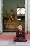 Burmese woman praying. Myanmar, Burma, Pyay, Burmese Buddhist woman praying Stock Photo