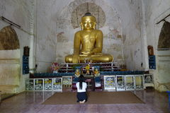 Burmese woman praying inside pagoda Stock Images