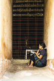 Burmese woman reading royalty free stock photo