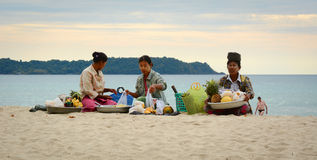 Burmese woman selling fresh fruits on Ngapali beach Royalty Free Stock Image