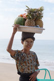 Burmese woman selling fresh fruits at the shoreline to tourists in Ngapali beach. Myanmar Stock Image