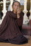Burmese woman smoking a Cheroot Stock Images