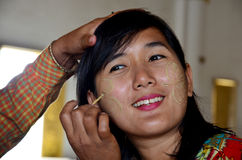 Burmese woman using tanaka makeup for traveler thai women at Atumashi monastery Royalty Free Stock Photography