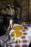 Burmese woman at work sewing beads Royalty Free Stock Images