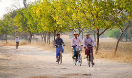 Burmese women biking on street in Bagan, Myanmar Stock Image