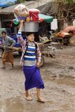 Burmese women carrying bag on head Stock Images