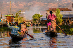 Burmese women rowing on wooden boats, Inle Lake, Myanmar Stock Image