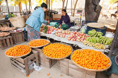 Burmese women selling fruits at market. Bagan, Myanmar Royalty Free Stock Images