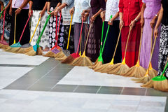 Burmese women washing the floor at Shwedagon Paya, Myanmar Stock Photography