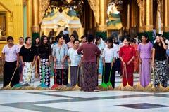 Burmese women washing the floor at Shwedagon Paya, Myanmar Stock Images