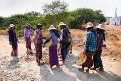Burmese women are working to build a road near Kalaw, Myanmar. stock photography