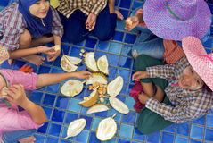 Burmese workers eating durian Royalty Free Stock Photography