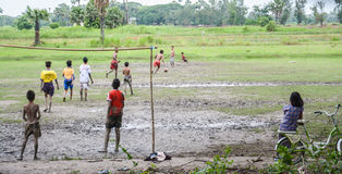 Burmese young men are playing football on rice filed in Inwa, Myanmar (Burma). Stock Image