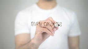 Burn Calories, man writing on transparent screen Stock Image
