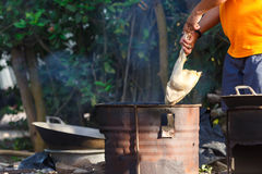 Burn chicken. A man burning a chicken for remove a feather before cooking,Local cleaning chicken in Thailand Stock Image