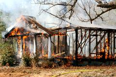 Burn down house fire Stock Photo
