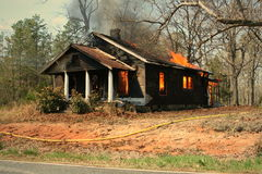 Burn down house fire Stock Images